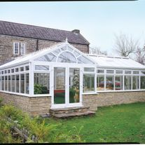 crown conservatory in a back garden